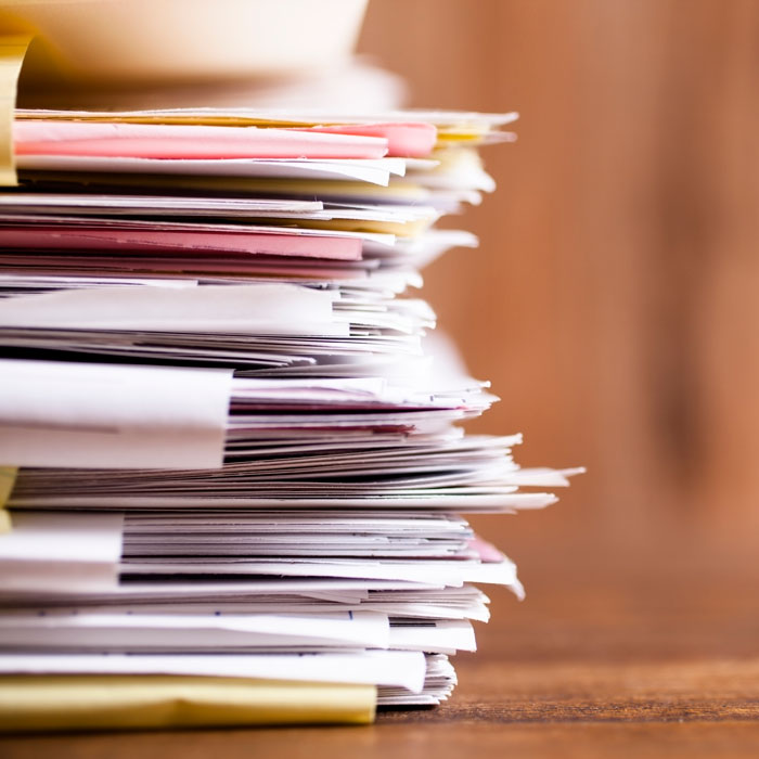 Picture of a stack of documents on a table
